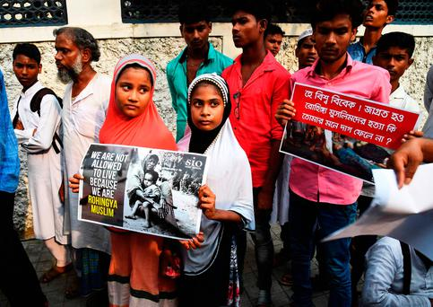 Indian Muslims in Kolkata hold placards to protest the treatment of Rohingya Muslims in Myanmar. Photo: Getty Images