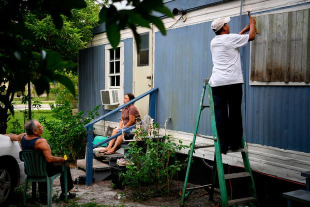 Residents use scavenged materials to protect their home in preparation for Hurricane Irma in Immokalee, Florida, U.S., September 8, 2017. REUTERS/Bryan Woolston