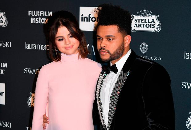 The Weeknd and Selena Gomez attend Harper's BAZAAR Celebration of 'ICONS By Carine Roitfeld' at The Plaza Hotel presented by Infor, Laura Mercier, Stella Artois, FUJIFILM and SWAROVSKI on September 8, 2017 in New York City. / AFP PHOTO / ANGELA WEISSANGELA WEISS/AFP/Getty Images