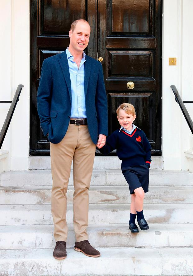 Handout photo released by the Duke and Duchess of Cambridge of the Duke of Cambridge with his son Prince George on his first day of school
