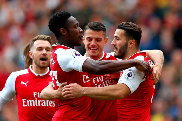 LONDON, ENGLAND - SEPTEMBER 09: Danny Welbeck of Arsenal celebrates scoring his sides first goal with Granit Xhaka of Arsenal and Sead Kolasinac of Arsenal during the Premier League match between Arsenal and AFC Bournemouth at Emirates Stadium on September 9, 2017 in London, England. (Photo by Clive Rose/Getty Images)