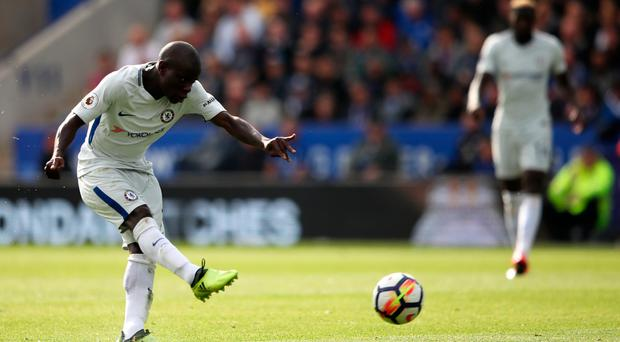 LEICESTER, ENGLAND - SEPTEMBER 09: N'Golo Kante of Chelsea scores his sides second goal during the Premier League match between Leicester City and Chelsea at The King Power Stadium on September 9, 2017 in Leicester, England. (Photo by Clive Mason/Getty Images)