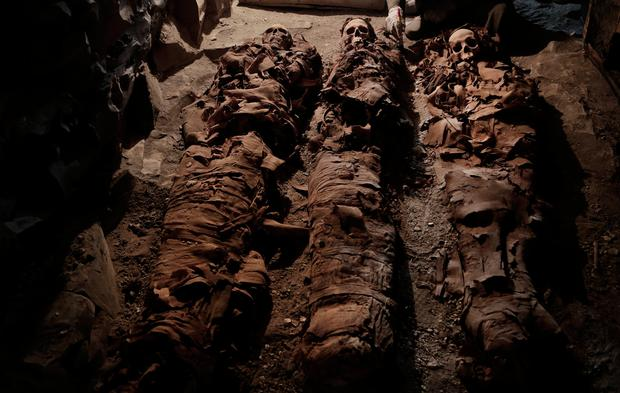 Mummies found in the New Kingdom tomb that belongs to a royal goldsmith in a burial shaft, in Luxor, Egypt, Saturday, Sept. 9, 2017. Egypt has announced the discovery in the southern city of Luxor of a pharaonic tomb belonging to a royal goldsmith who lived more than 3,500 years ago during the reign of the 18th dynasty. (AP Photo/Nariman El-Mofty)