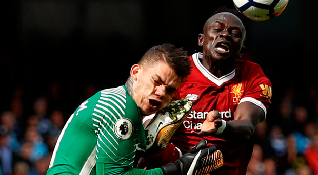 Sadio Mane collides with Manchester City goalkeeper Ederson during yesterday's game at the Ethihad Stadium in an incident which resulted in a red card for the Liverpool player. Photo: Lee Smith. Photo: Reuters