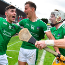 Limerick players (l to r) Barry Nash, Tom Morrissey and Cian Lynch celebrate at the final whistle. Photo: Sportsfile