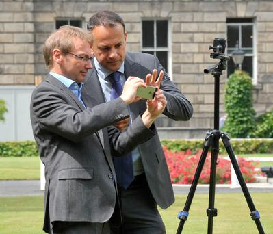On film: Taoiseach Leo Varadkar on the lawn of Government Buildings last week filming his weekly video message Photo: John Dardis