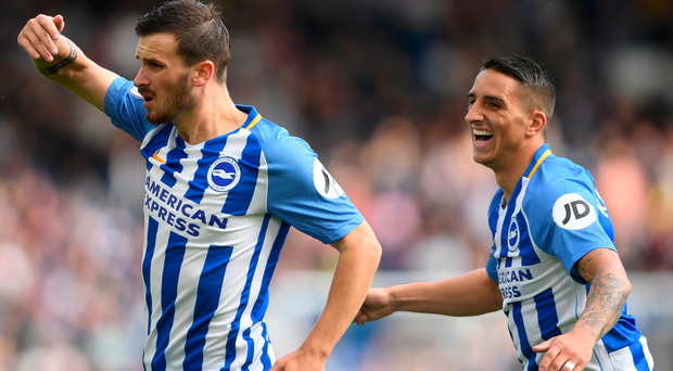 Pascal Gross of Brighton celebrates with Anthony Knockaert after scoring his second goal