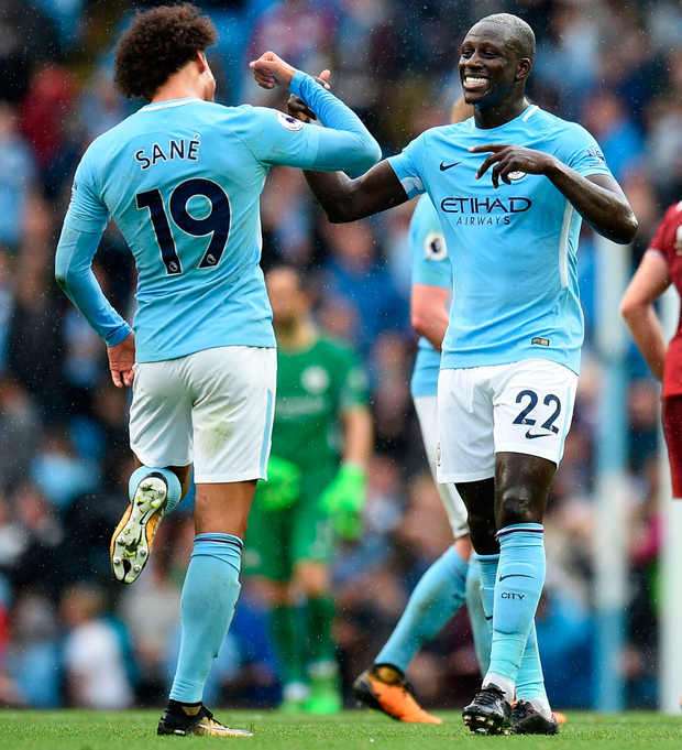 Manchester City's German midfielder Leroy Sane and French defender Benjamin Mendy celebrate at the final whistle. Photo: Getty Images