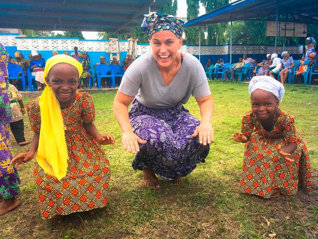 Maria Walsh doing charity work with young girls in Ghana