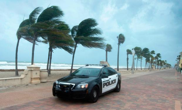 A police car patrols the beach in anticipation for Hurricane Irma, in Hollywood, Fla., Saturday, Sept. 9, 2017. (Paul Chiasson/The Canadian Press via AP)