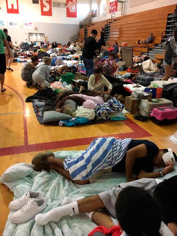People take shelter at Key West High School in Key West, Florida, U.S. as Hurricane Irma approaches, in this September 9, 2017 still image taken from social media.