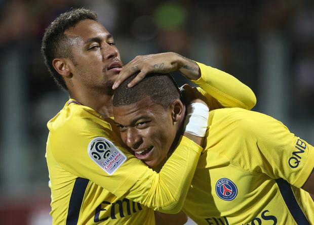 Kylian Mbappe of PSG celebrates his goal with Neymar Jr during the French Ligue 1 match between FC Metz and Paris Saint Germain (PSG) at Stade Saint-Symphorien on September 9, 2017 in Metz, France. (Photo by Jean Catuffe/Getty Images)