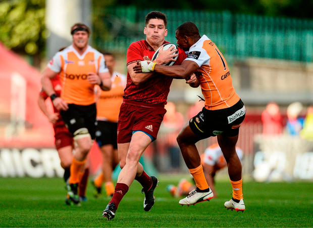 Alex Wootton of Munster is tackled by Makazole Mapimpi of Cheetahs. Photo by Diarmuid Greene/Sportsfile