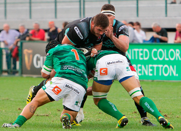 Wiehahn Herbst of Ulster is tackled by Federico Zani of Benetton Treviso. Photo by Daniele Resini/Sportsfile