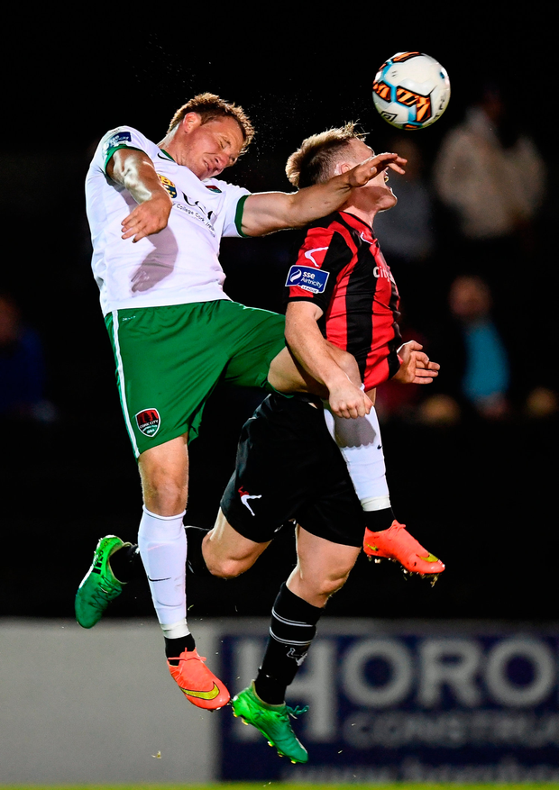 Achille Campion of Cork City in action against Daniel O'Reilly of Longford Town. Photo by Stephen McCarthy/Sportsfile
