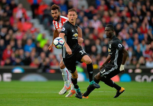 Manchester United midfielder Nemanja Matic battles for the ball with Stoke's Eric Maxim Choupo-Moting on Saturday. Photo: REUTERS