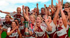 Westmeath players celebrate with the Kathleen Mills cup. Photo by Piaras Ó Mídheach/Sportsfile