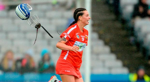 Ashling Thompson discards her helmet as the celebrations begin in Croke Park. Photo by Piaras Ó Mídheach/Sportsfile