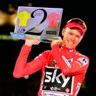 Team Sky's Chris Froome celebrates on the podium in Madrid yesterday after winning the Vuelta a Espana to complete a rare Tour-Vuelta double. Photo: Getty Images