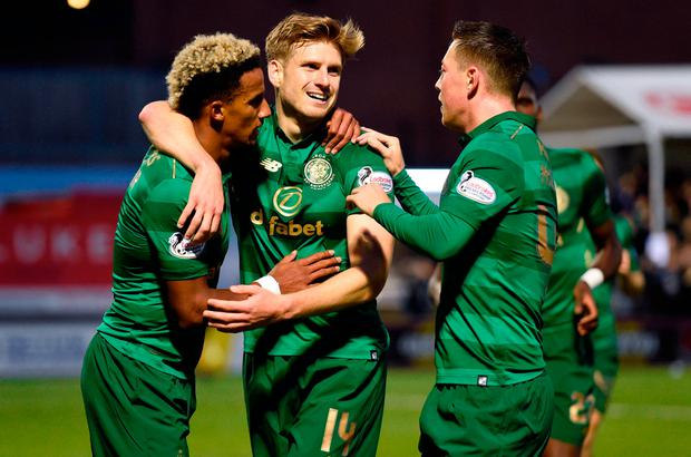 Celtic's Stuart Armstrong (second left) celebrates scoring his side's first goal against Hamilton last Friday with team-mates Scott Sinclair (l) and Callum McGregor. Photo: PA