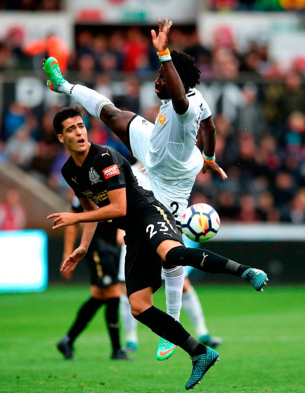 Newcastle United's Henri Saivet and Swansea City's Wilfried Bony battle for the ball
