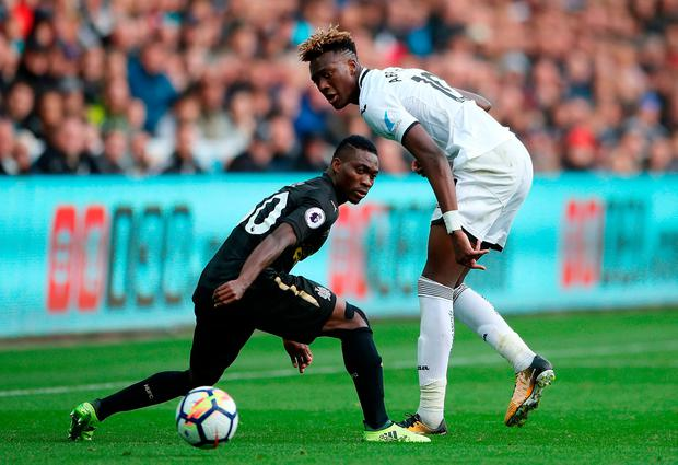 Swansea City's Tammy Abraham (right) and Newcastle United's Christian Atsu (left) in action. Photo credit: Nick Potts/PA Wire
