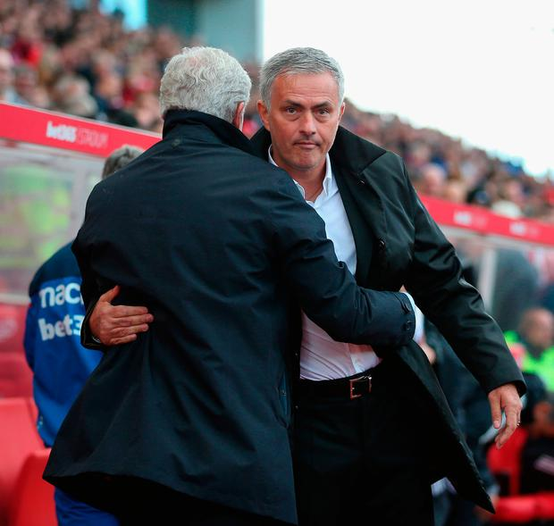 Stoke manager Mark Hughes and Manchester United manager. Photo by Alex Morton/Getty Images