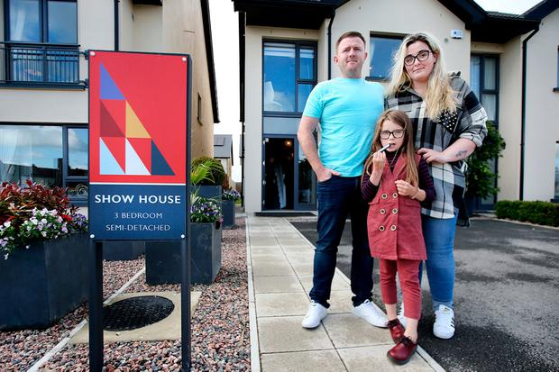 Mark McConnell with his partner Kelly Fitzsimons and her daughter Ella May Melia (7). Photo: Steve Humphreys