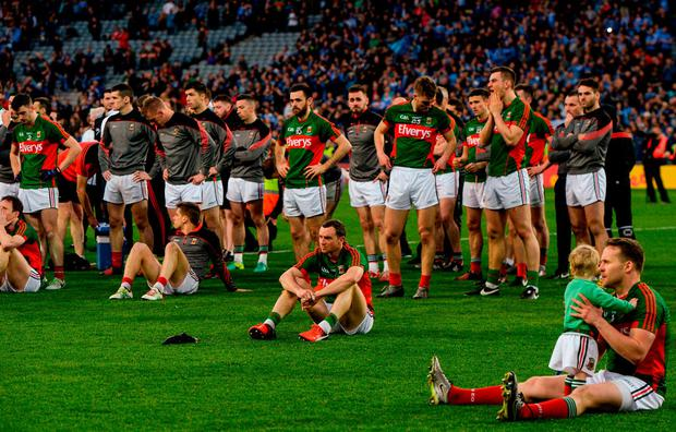 Mayo players sit dejected in Croke Park after last year's defeat to Dublin in the replay – they have the perfect chance for revenge on Sunday. Photo by Piaras Ó Mídheach/Sportsfile