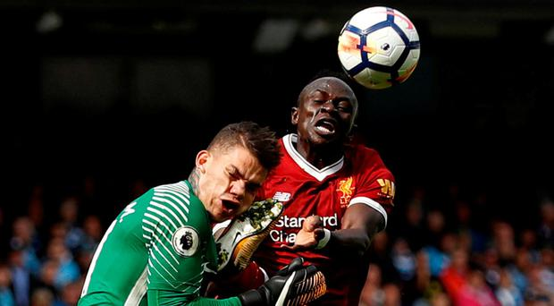 Manchester City's Ederson feels the weight of Sadio Mane's boot on Saturday. Photo: Action Images via Reuters