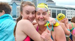 Heather (14) hugs her mother, the women's race winner Anne-Marie Bourke, from the Dublin Swimming Club, after they both competed in the 98th Dublin City Liffey Swim on Saturday. More than 500 competitors took part in the race that has been going since 1920. Photo: Barbara Lindberg