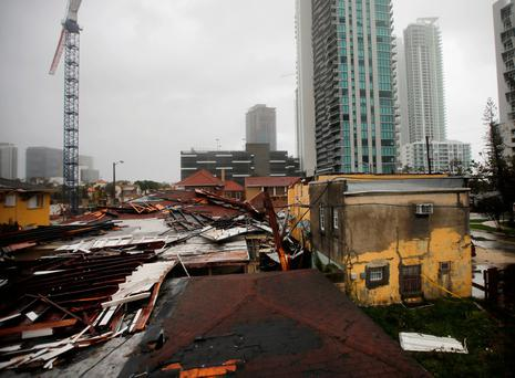 Destroyed roofs at a residential areas are seen as Hurricane Irma passes south Florida. Photo: Reuters/Carlos Barria