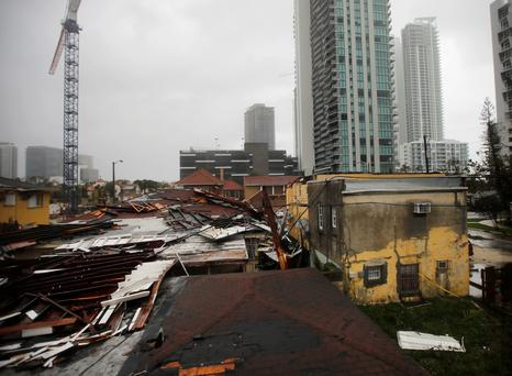 Destroyed roofs at a residential areas are seen as Hurricane Irma passes south Florida, in Miami, U.S. September 10, 2017. REUTERS/Carlos Barria