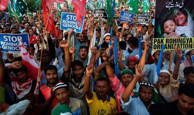 Supporters of Jamaat-e-Islami, a Pakistani religious group, chant slogans during a rally to condemn ongoing violence against the Rohingya Muslim minority in Myanmar, in Karachi, Pakistan, Sunday, Sept.10, 2017. (AP Photo/Fareed Khan)