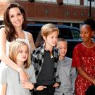 Executive producer Angelina Jolie arrives on the red carpet with her children, Vivienne Jolie-Pitt, Shiloh Jolie-Pitt, Knox Leon Jolie-Pitt, and Zahara Jolie-Pitt, for the film