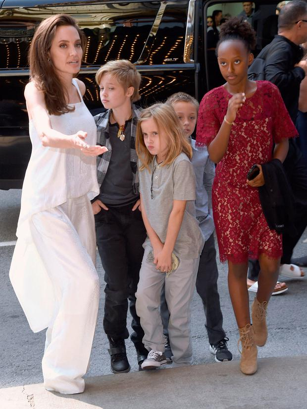 Angelina Jolie, from left, and her children Shiloh Jolie-Pitt, Vivienne Jolie-Pitt, Knox Jolie-Pitt and Zahara Jolie-Pitt, arrive at a premiere for