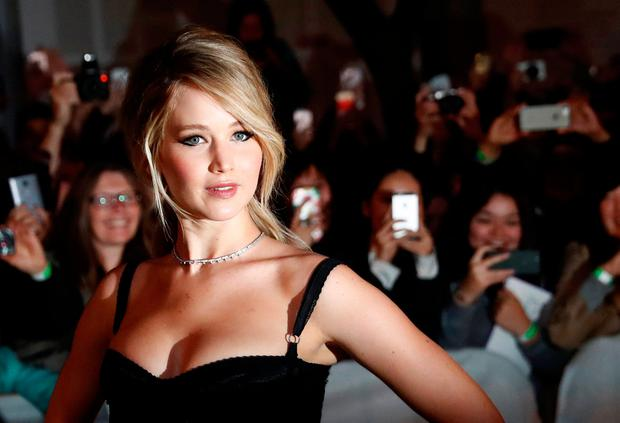 Actor Jennifer Lawrence arrives on the red carpet for the film