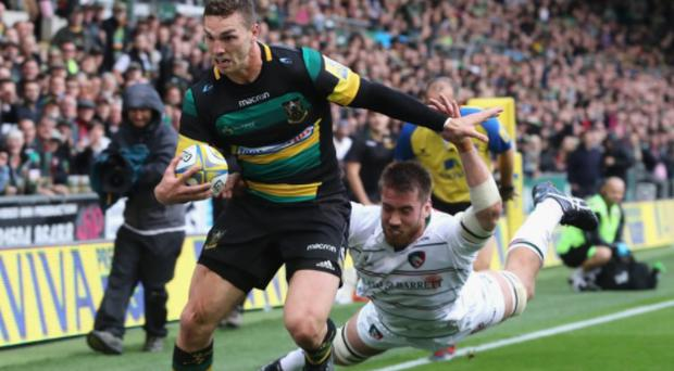 Dominic Ryan attempts to tackle George North. CREDIT: GETTY IMAGES