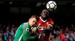 Manchester City's Ederson Moraes is fouled by Liverpool's Sadio Mane resulting in a red card for Mane