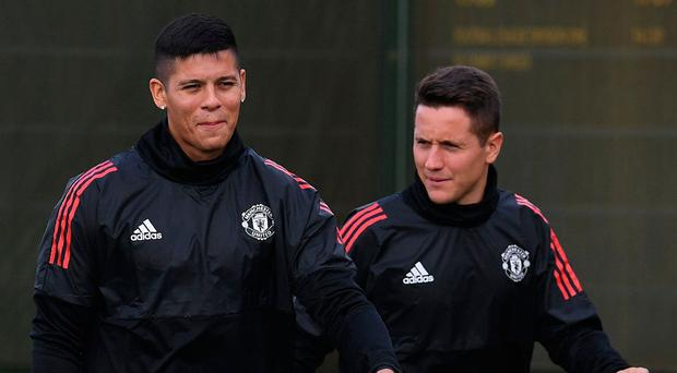 Manchester United defender Marcos Rojo and midfielder Ander Herrera at training in Carrington yesterday. Photo: Paul Ellis/AFP