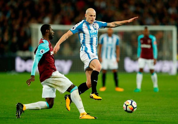 Huddersfield Town's Aaron Mooy in action with West Ham United's Pedro Obiang. Photo: John Sibley/Reuters