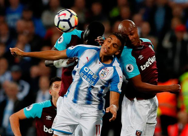 Huddersfield Town's Abdelhamid Sabiri in action with West Ham United's Andre Ayew and Cheikhou Kouyate. Photo: David Klein/Reuters