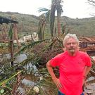 Richard Branson among the debris on his private island. Photo: Virgin.com/PA Wire
