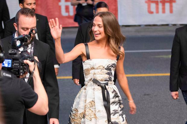 Alicia Vikander waves to fans during the premiere of 'Euphoria' at the Toronto International Film Festival in Toronto, Ontario, September 11, 2017. / AFP PHOTO / Geoff RobinsGEOFF ROBINS/AFP/Getty Images