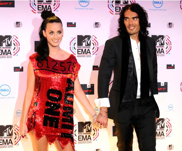 US singer Katy Perry poses with her husband, British comic Russell Brand on the red carpet on November 7, 2010 prior the 2010 MTV Europe Music MTV (EMA) host in Madrid.AFP PHOTO/ DOMINIQUE FAGET