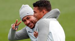 Paris St Germain's Neymar and Thiago Silva during training