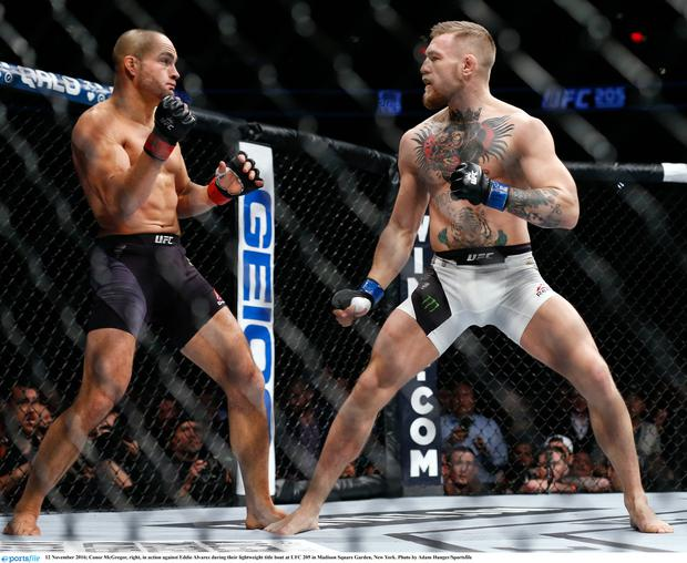 Conor McGregor, right, in action against Eddie Alvarez during their lightweight title bout at UFC 205 in Madison Square Garden