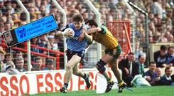 Dessie Farrell tries to escape the clutches of Noel Hegarty during the 1992 All-Ireland final