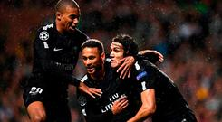 PSG strikers (l-r) Kylian Mbappe, Neymar and Edinson Cavani celebrate after the Brazilian's opening goal last night. Photo: Franck Fife/AFP/Getty Images