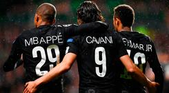 Paris Saint-Germain's Brazilian striker Neymar (R) celebrates with Paris Saint-Germain's French striker Kylian Mbappe (L) and Paris Saint-Germain's Uruguayan striker Edinson Cavani (C) after scoring the opening goal of the UEFA Champions League Group B football match between Celtic and Paris Saint-Germain (PSG) at Celtic Park in Glasgow, on September 12, 2017. / AFP PHOTO / FRANCK FIFEFRANCK FIFE/AFP/Getty Images